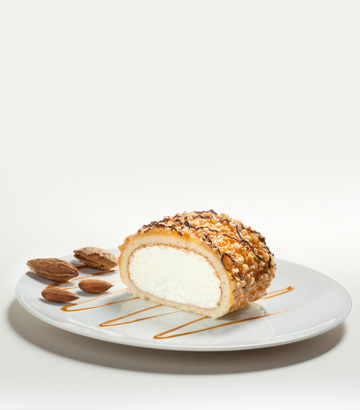 Cream swiss roll with a  crunchy topping